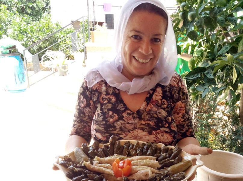 Ibtisam Fares serves breakfast. Linda Gradstein/The Media Line