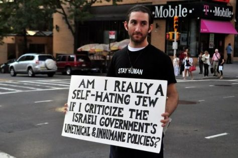 "Protesters stand silently during the demonstration holding their placards and signs. -- The ""Jews Say No"" movement held a protest in Upper Manhattan expressing their opposition to the recent air attacks on the Gaza strip. Protesters stood silently, holding posters and placards which voiced their concerns. New York, USA. 22nd August 2011"