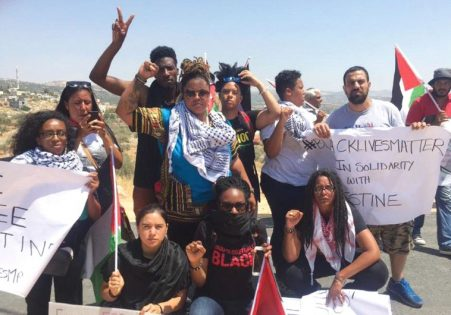BLACK LIVES MATTER activists pose in Bil'in, a Palestinian village west of Ramallah on Friday.. (photo credit:FACEBOOK/BLACK LIVES MATTER)