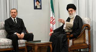Iran's Supreme Leader Ayatollah Ali Khamenei (R) speaks with Turkish officials while meeting Turkey's Prime Minister Tayyip Erdogan in Tehran December 3, 2006. REUTERS/ISNA (IRAN) - RTR1K0EK