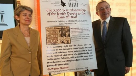 UNESCO's Director General Irina Bokova poses with the Simon Wiesenthal Center's Rabbi Marvin Hier and a poster for the original exhibit on the Jewish people's 3,500-year connection to the land of Israel, in January. (photo credit: Courtesy Simon Wiesenthal Center)